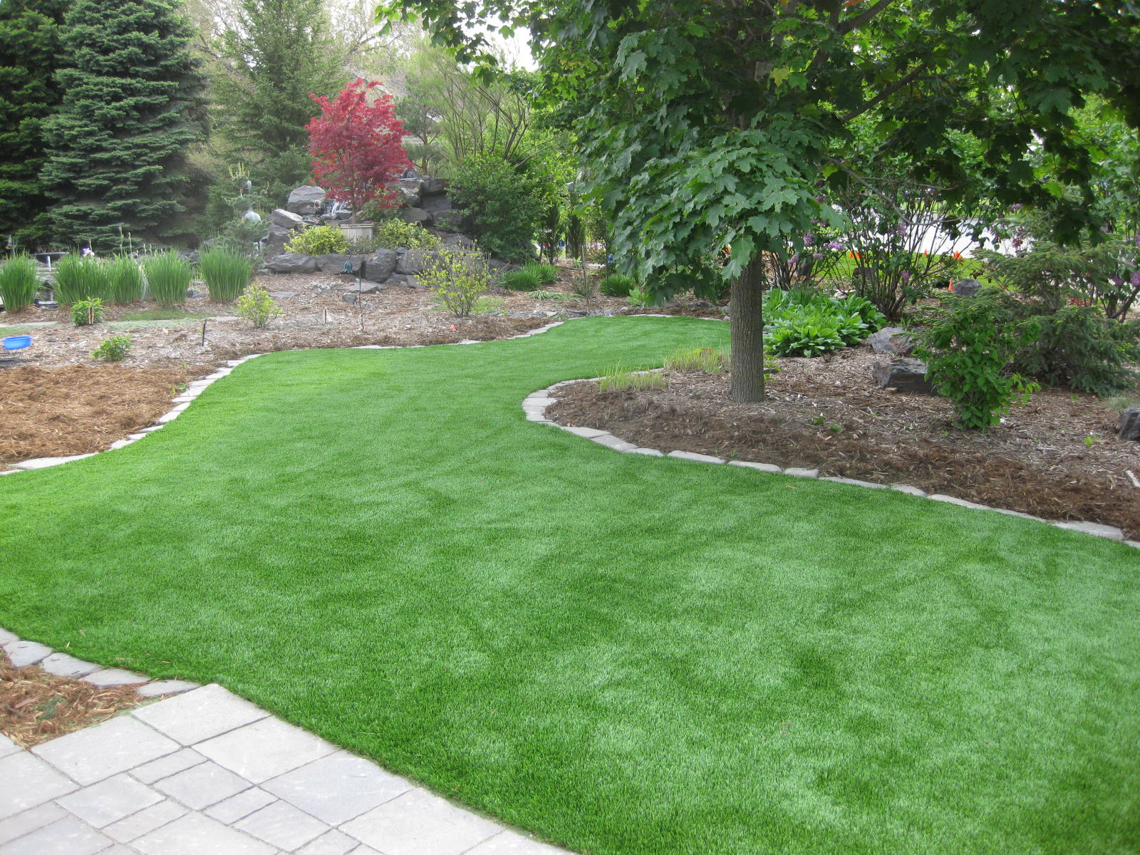 artificial turf yard. XGrass Artificial Grass Lawns Remain Lush, Vibrate And Professionally Manicured Throughout The Year. Turf Yard